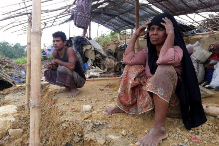 A Rohingya refugee sitting near a house destroyed by Cyclone Mora in a camp in the Cox's Bazar on May 31. (AFP)