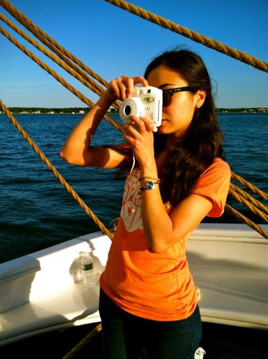 Ingkar taking a picture on her instacamera in US (from personal archive)