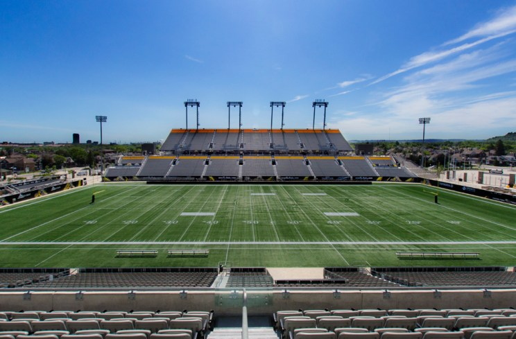 view of a football field from the empty stands