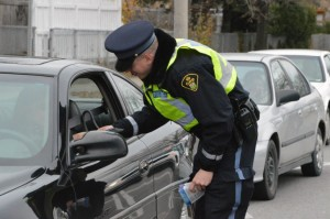 Const. Greg Turpin hands out R.I.D.E. Check booklets at the first R.I.D.E. Check of the festive season, hosted at Humber's North campus.