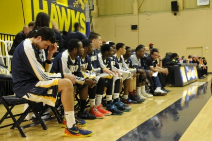 The Humber Hawks men's basketball team looks on as they take on the rival Mohawk Mountaineers.