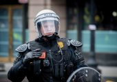 Security forces donned riot gear to help disperse protestors on inauguration day. Photo by Tyler Bloomfield