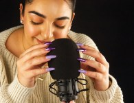 Michelle Halim delicately taps her nails on a microphone. The sound can give an intense tingling feeling to some, while others find the sound unbearable. (Photo by Kateryna Horina)