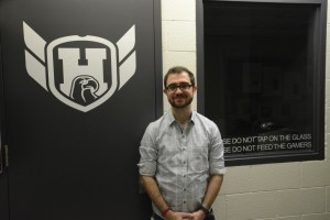 Geoffrey lachapelle in front of the esports training room.