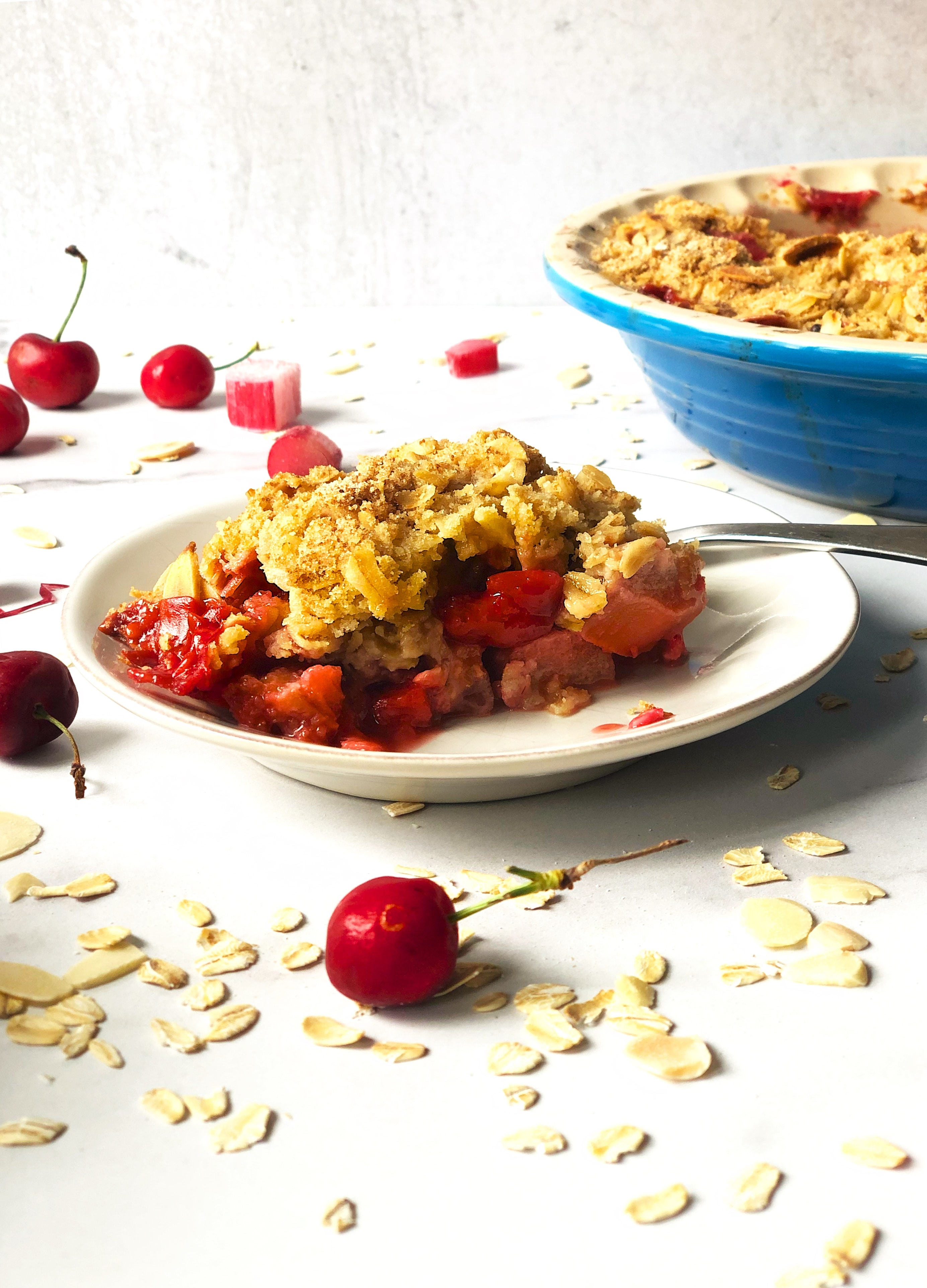 Slice of Summer Fruit Crisp - Strawberries, Rhubarb, Cherries in a buttery crisp with oats and almonds