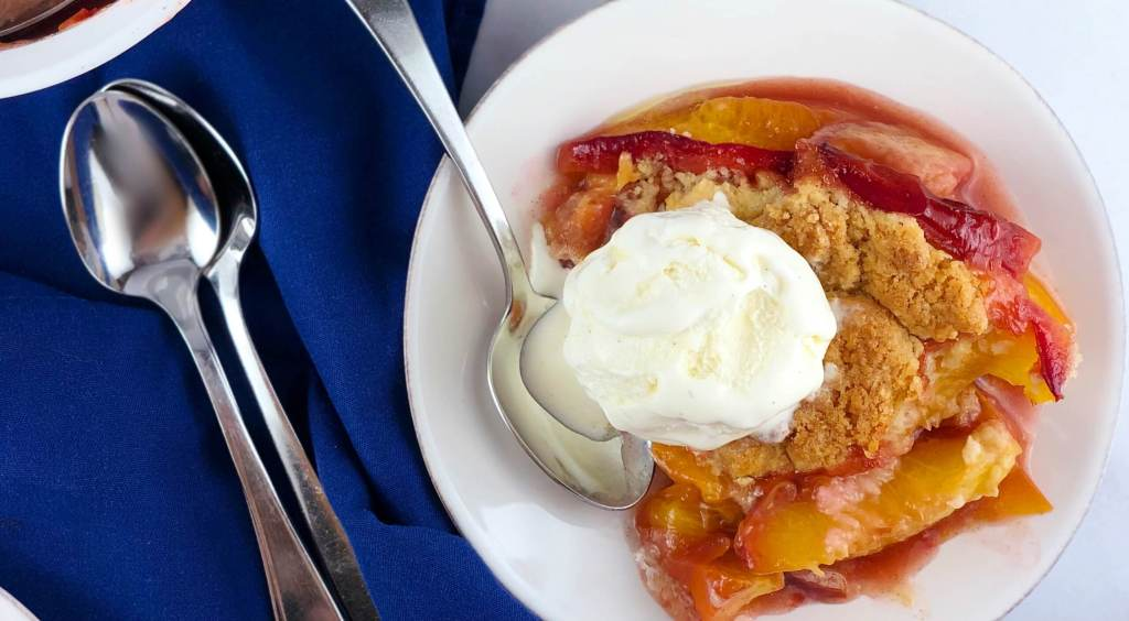 Plate of Peach Cobbler with Ice Cream