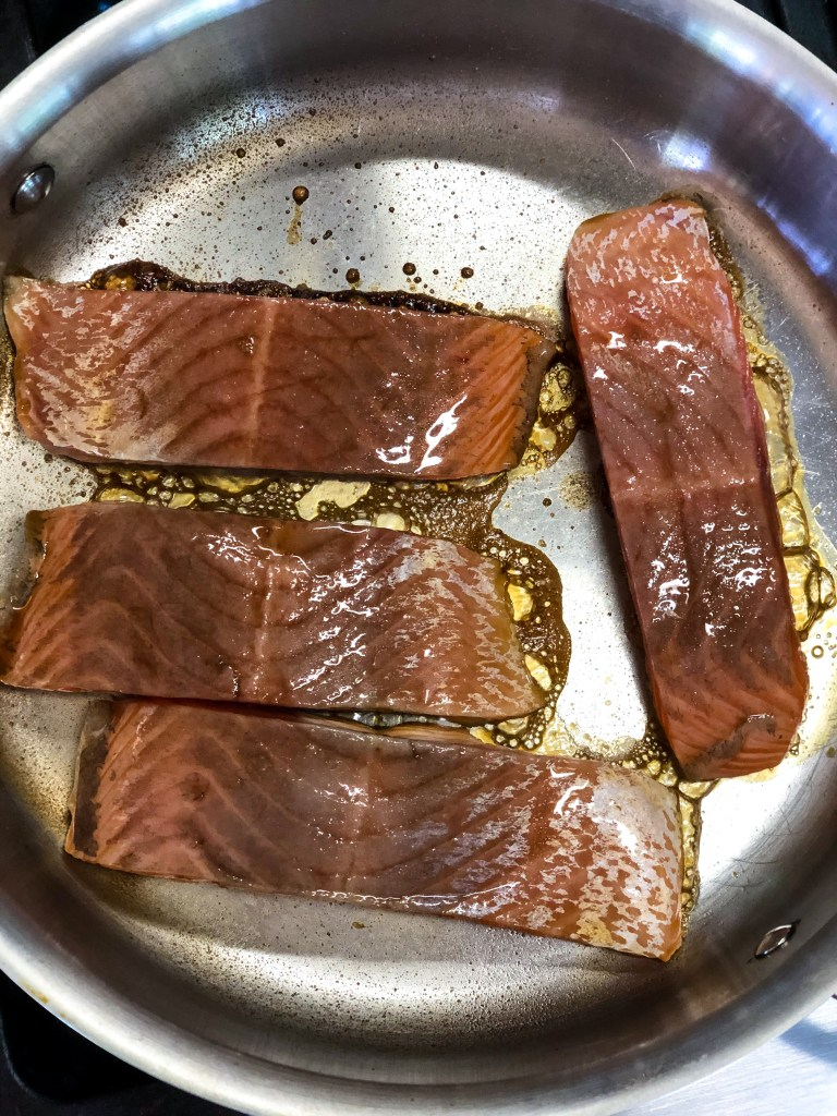 process shot of cooking salmon