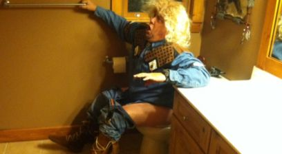 man in wig on toilet