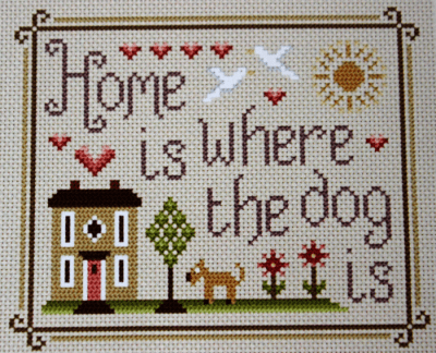 gesticktes Bild mit der Aufschrift Home is where the dog is