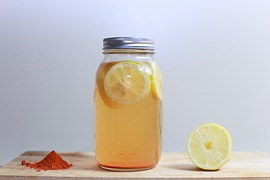 Mason jar filled with lemonade demonstrates how to avoid waste