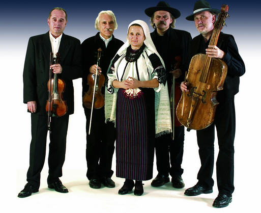 The Muzsikás group with Mária Petrás in Csángó folk costume