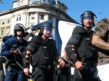 Riot cops protecting paraders (2007).