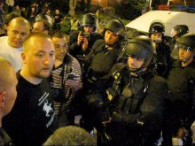 Riot police prepare to arrest Tomcat for leading an unauthorized demonstration (4/11/2008).