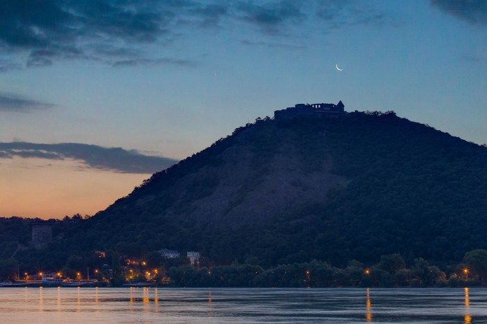 Visegrad Castle in dawn with Moon, Jupiter and Venus