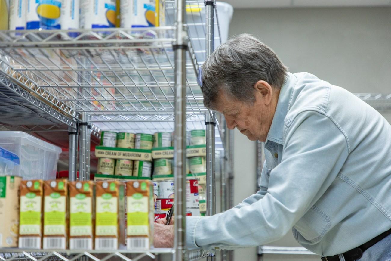 Woman volunteering stacking food