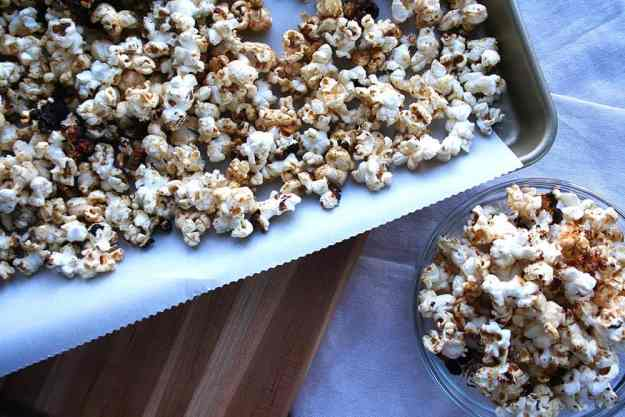 overhead shot of sweet and spicy popcorn in a bowl and on a cookie sheet
