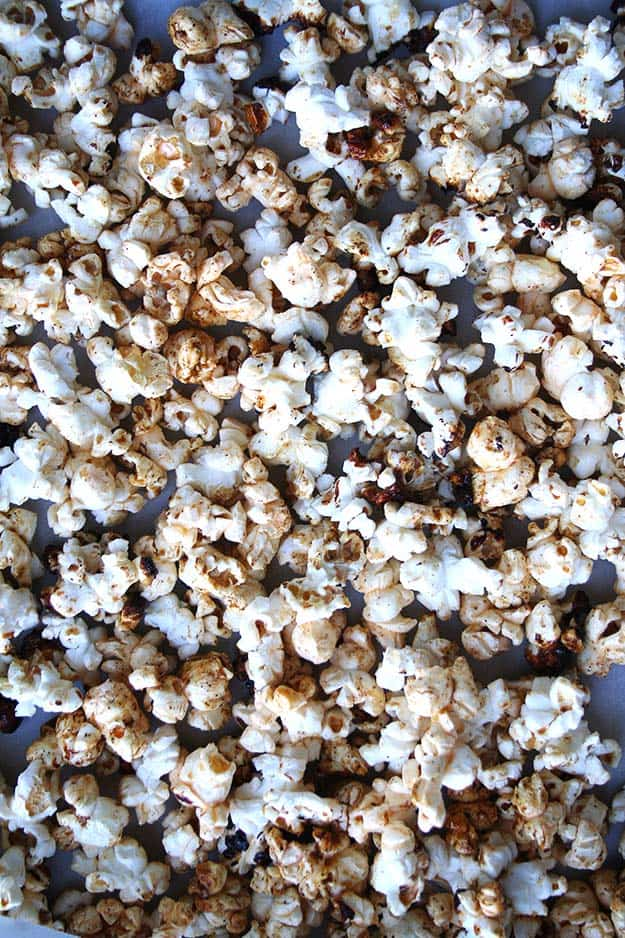 a full tray of sweet and spicy popcorn coated in sugar and cayenne pepper