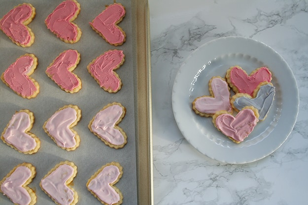 pink and purple ombre frosted heart shaped sables on a cute plate for Valentine's Day