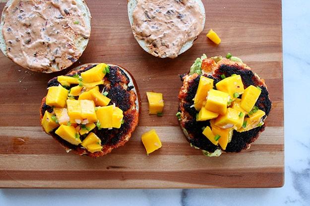 Blackened Salmon Burgers with Mango-Jalapeno Salsa, Smashed Avocado, and Chipotle Mayo | hungrybynature.com
