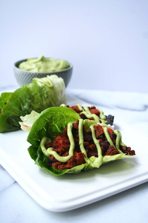 Soy Chorizo Lettuce Wraps topped with a Creamy Avocado-Lime Sauce | Hungry by Nature