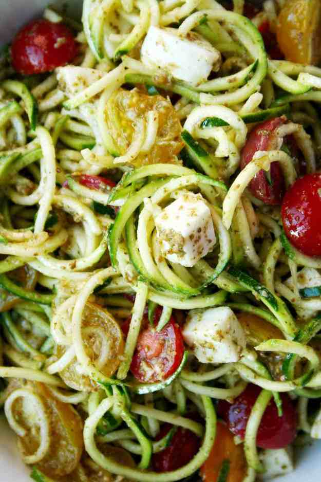 Fresh mozzarella, tomatoes, pesto, and zucchini are all you need for a simple summer Caprese Zoodle Salad! | Hungry by Nature