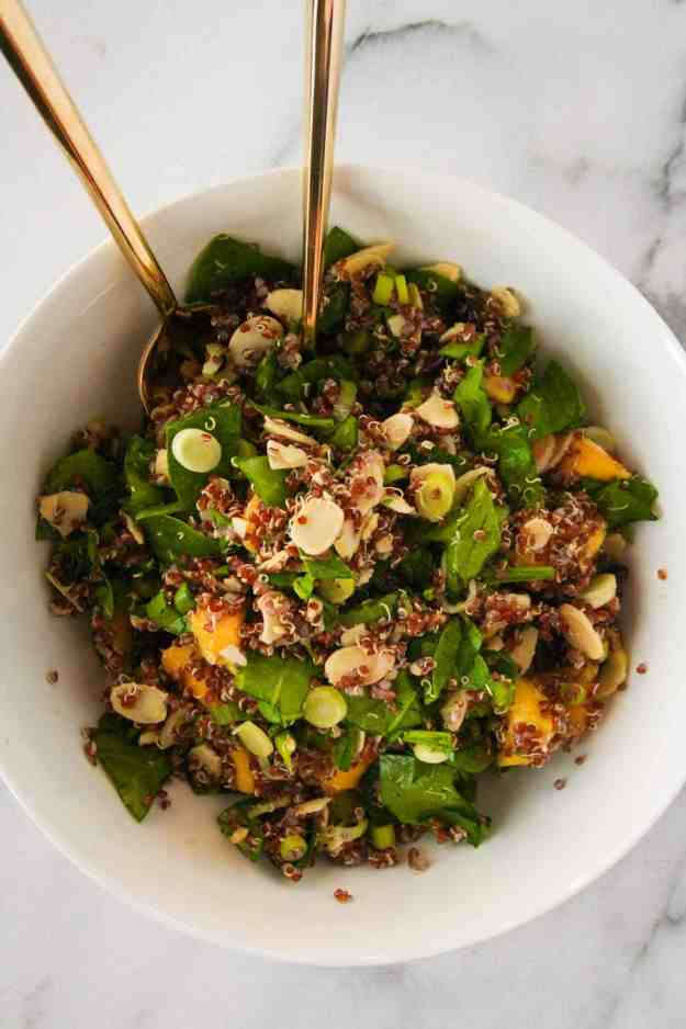 The perfect summer quinoa salad stuffed with mangos, spinach, almonds, and cranberries. | hungrybynature.com