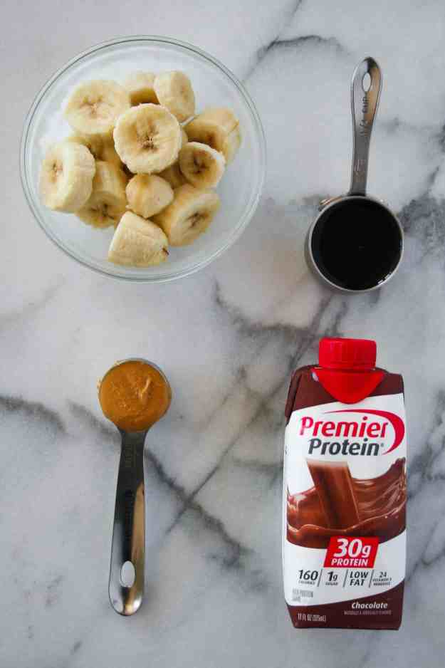 4 simple ingredients are all you need to make the ultimate chocolate protein shake - Premier Protein, frozen banana, peanut butter and cold brew! | Hungry by Nature