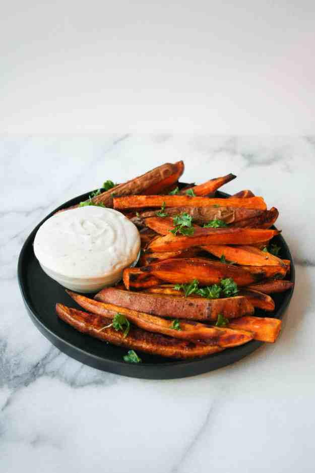 The perfect side to tonight's dinner - baked sweet potato fries with tahini dip... fast, healthy, and delicious! | Hungry by Nature