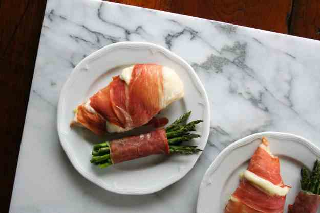 On your table in under 30 minutes, this provolone and proscuitto wrapped chicken couldn't be easier for a hearty week night meal! | Hungry by Nature