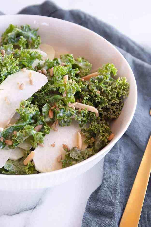 Shaved Kohlrabi and Kale Salad with Lemon-Tahini Dressing | kohlrabi recipe, raw, spiralized, easy, healthy, gluten free, dairy free, paleo, vegan, whole30 | hungrybynature.com