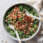 a bowl of shaved brussels sprout salad with kale, bacon and a creamy tahini dressing