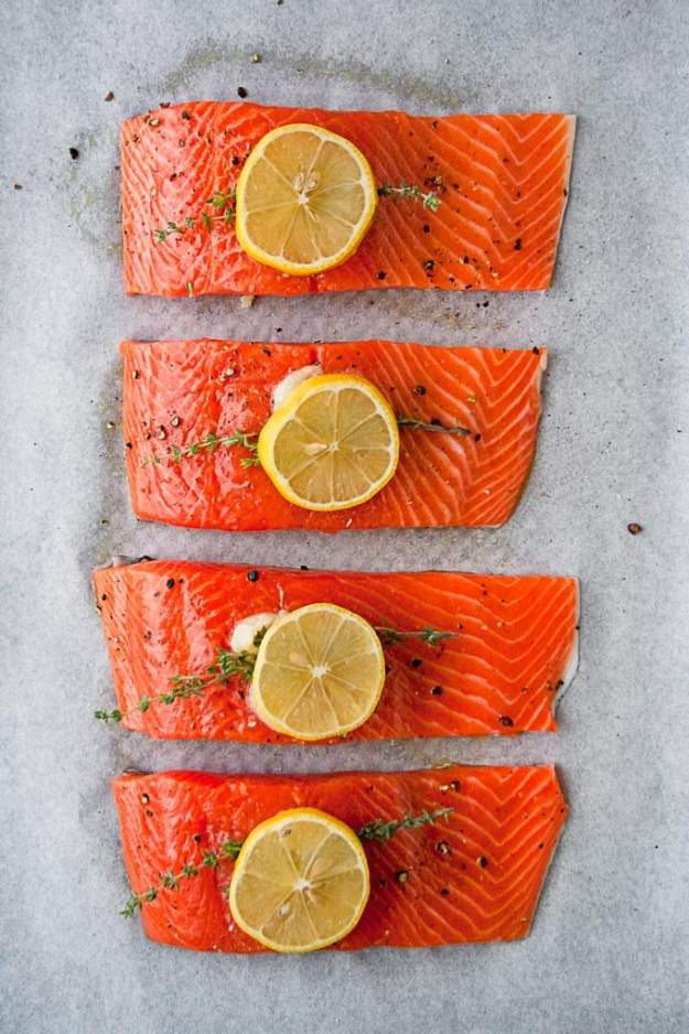 overhead shot of whole30 lemon salmon recipe on a sheet pan before baking