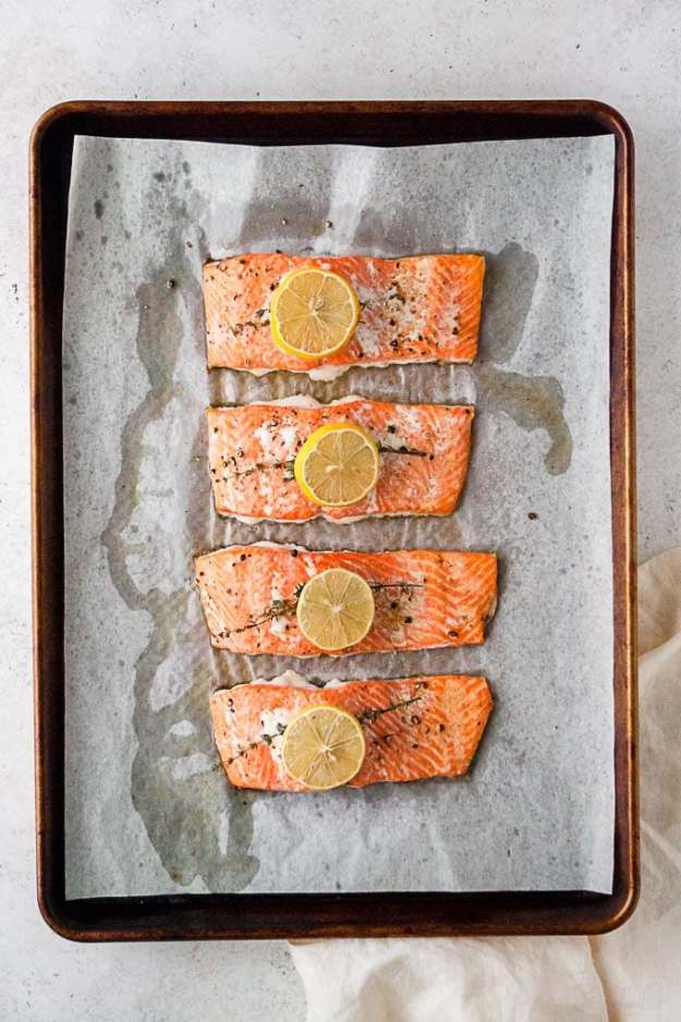 overhead shot of whole30 simple roasted lemon salmon recipe on a sheet pan