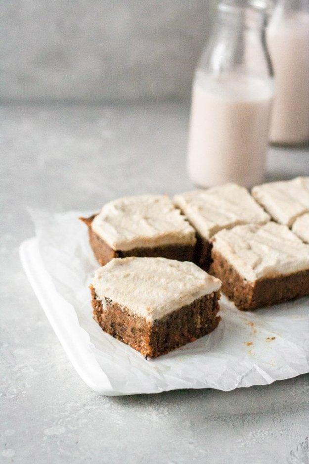 raw vegan carrot cake bars on white plate with milk