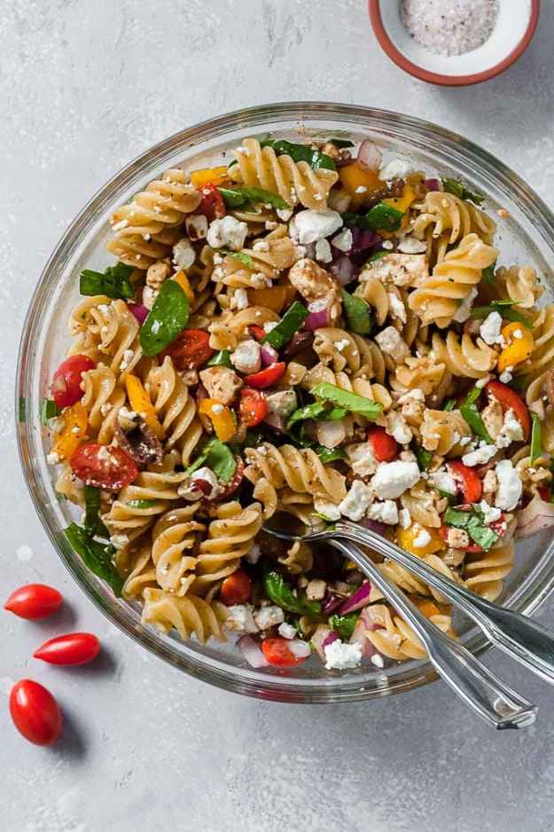 overhead shot of simple greek summer pasta salad with two spoons
