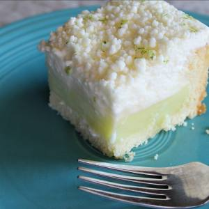 White Chocolate + Lime Icebox Cake! The super-sweet, soft white chocolate flavor with the tart and sweet lime is a winner for sure. And because they're chilled together in this no-bake dessert, it is cool and refreshing from start to finish!