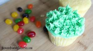 Soft cupcakes with a playful scene of bunnies in the grass on top. And a sweet surprise in the middle!