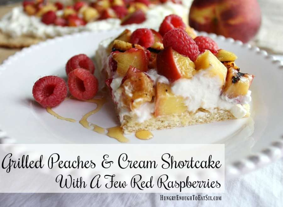A tender shortcake holds creamy mascarpone whipped cream and swirls of honey. Grilled peaches are piled on with a few red raspberries. It's a decadent and eye-catching dessert!
