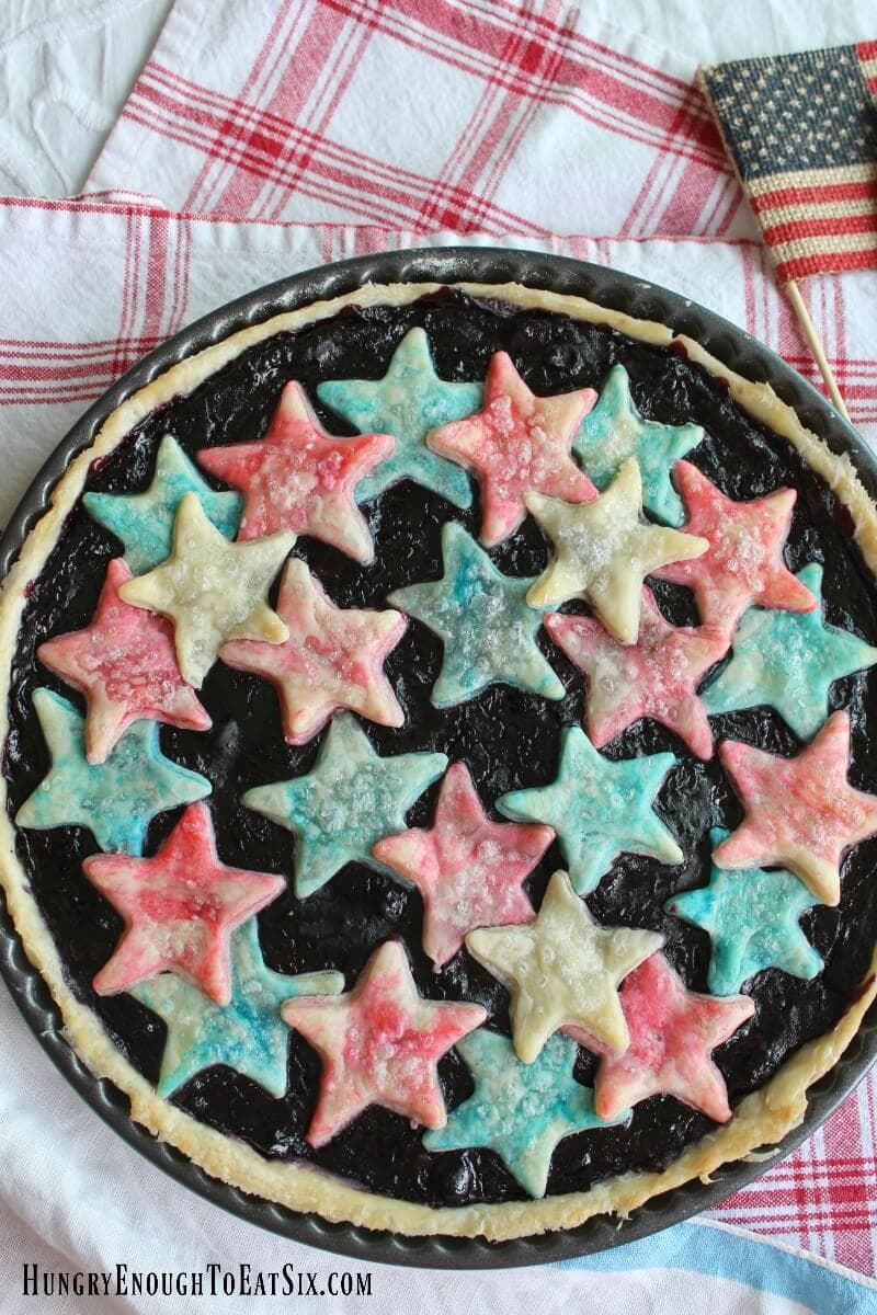 A summery fruit tart with a sweet filling of cherries and blueberries! And atop the tart a few red, white and blue stars - for the 4th of July or anytime.