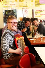 Accordian Player at one of Paris's bustling cafes