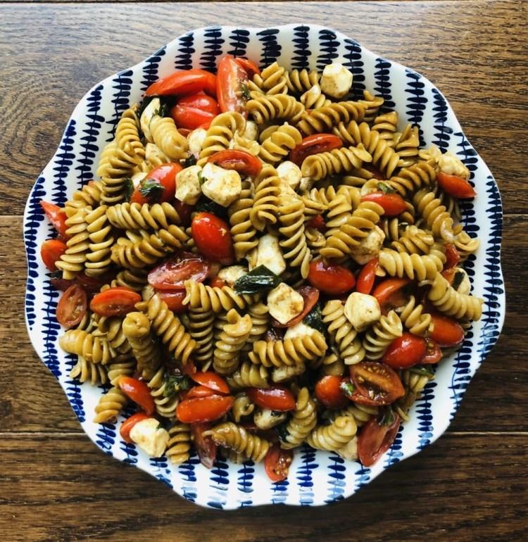 A bowl of caprese pasta salad