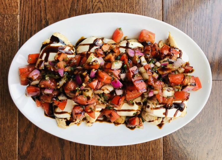 Plate with four servings of bruschetta chicken