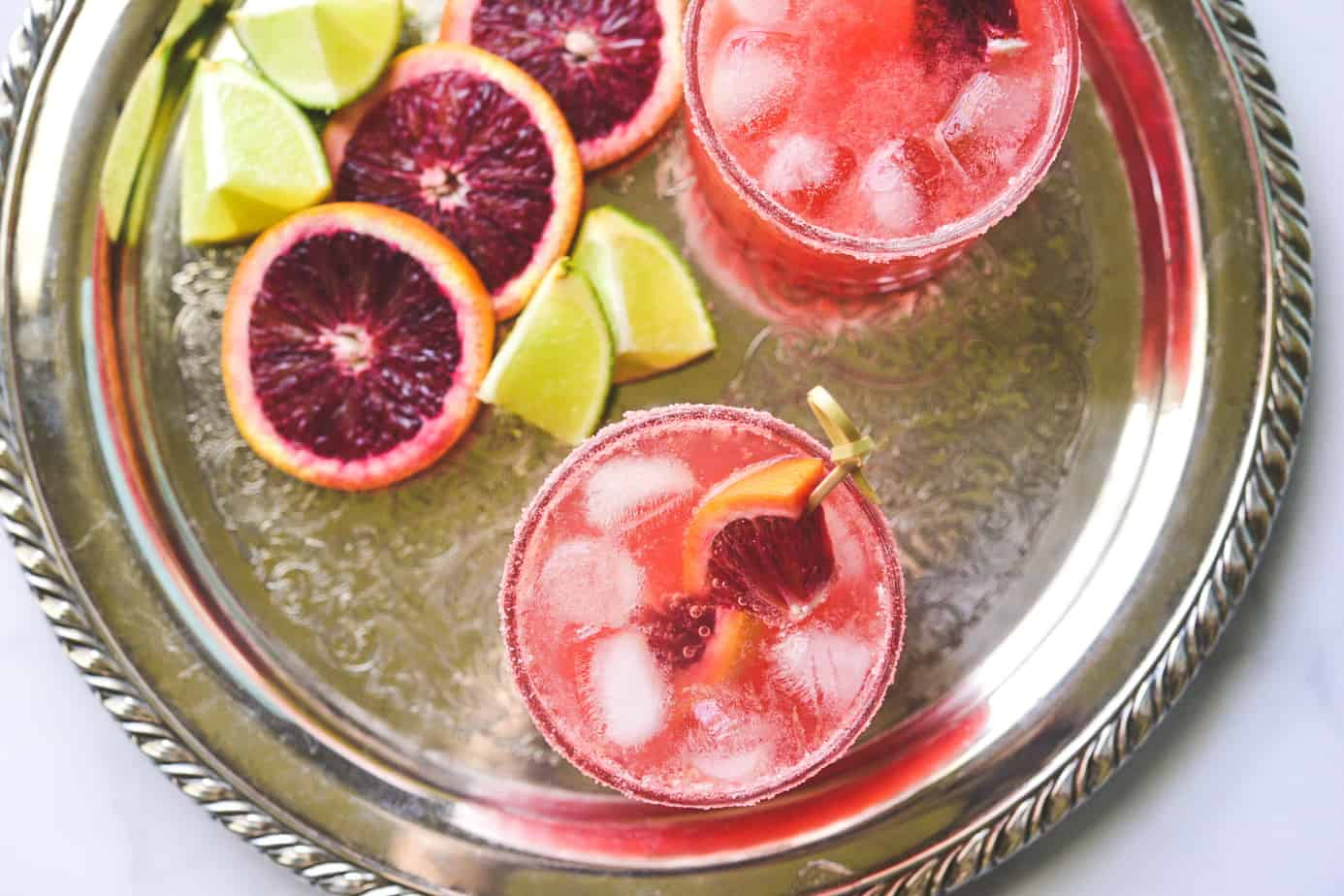 This is the best blood orange margarita, with fresh blood orange and lime juice,Tequila and Topo Chico.