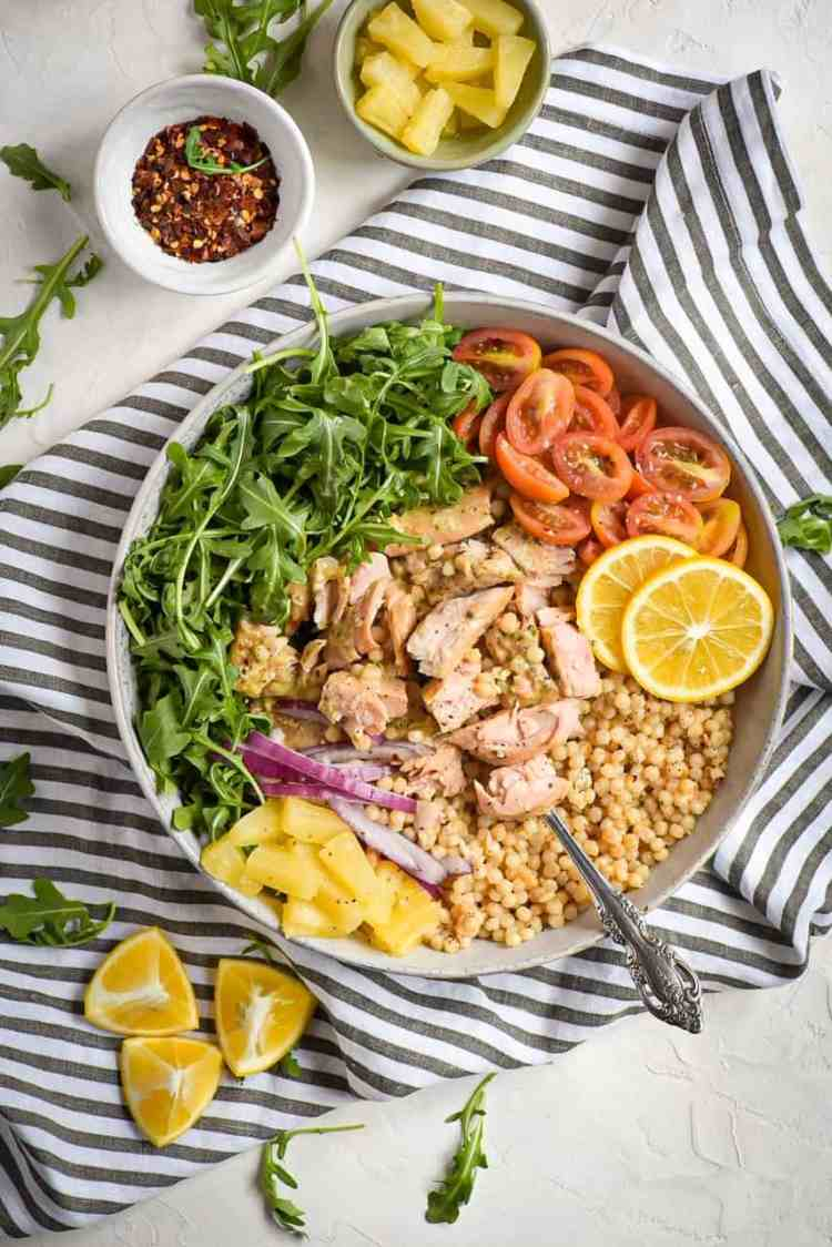baked roasted garlic and butter salmon with couscous tropical bowl