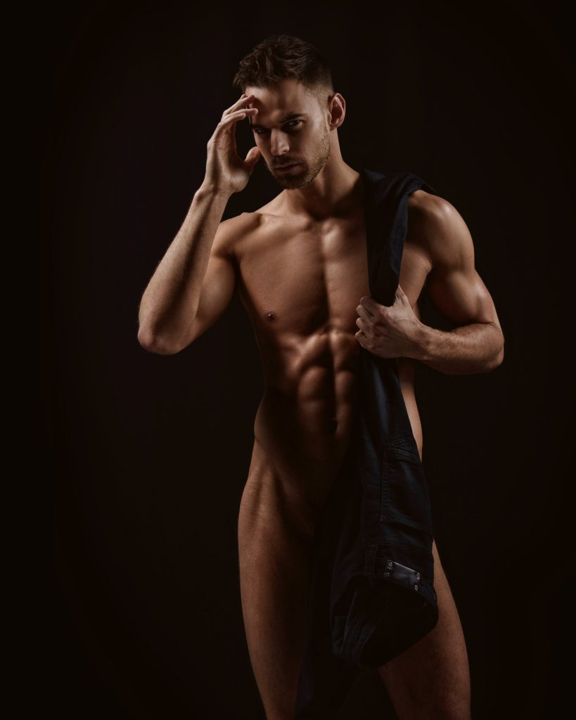 Sexy male model Thom Panto teasing in a naked photo