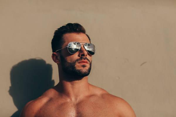 Male model Quin Bruce in shades in the sun