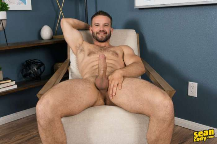 uncut hunk Jackson sitting back and showing his thick uncut cock