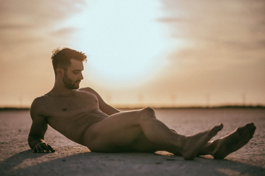 naked male model Vivien Mistral at the beach in a sunset