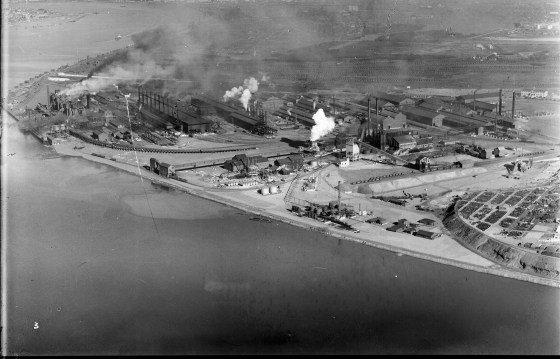 Newcastle, Port Hunter, BHP, three Blast Furnances, Raw Materials Trestle, 10 Open hearth stacks, 7 Soaking Pit stacks, Coke Screen House and Bins, By-Product Plant, Coppee-Wilputte Coke Ovens, Pig Mills, New By-Product Plant, Spares Area and Slag Dump. (Photograph by Milton Kent Airplane Photographs, Sydney. Southern No. 64.9.-.1935.S.jpg)