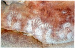 """Photo Credit: Jim Mitchell 2015. Annotation by Brian Laut on reverse side of photograph: """"A clash of tribes? Red ochre hand stencils (Wirangidi) and white ochre hand stencils (coastal tribes) Must have been a meeting place?"""""""